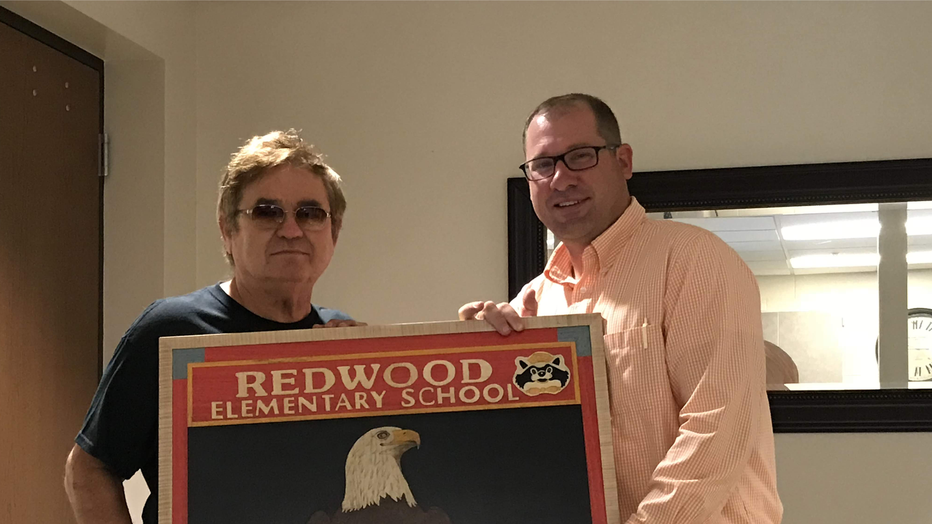 Principal TJ and Redwood Sign