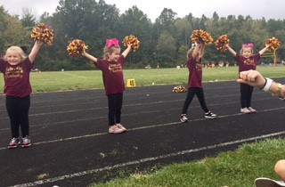 Learwood Middle School Cheerleaders cheering on the track